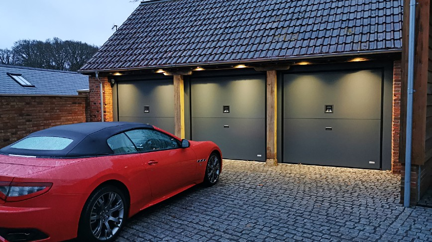 New triple garage doors installation