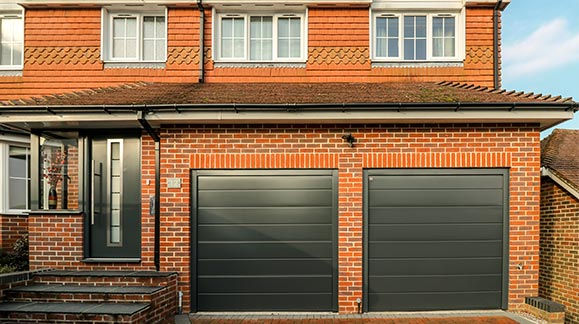 front entrance door and garage doors at Salisbury property